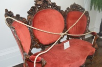 Original restored chair/settee...bought back for $18,000.