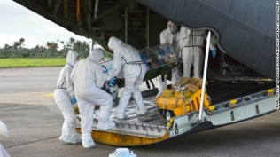 CNN: Loading a patient onto a plane in Sierra Leone