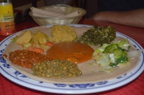 Beyaynetu aka veggie platter (lentils, gomen, cabbage, potatoes, red lentils, chickpea powdersoup (shiro) and injera)