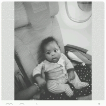 Flying from America - barely 4 months old